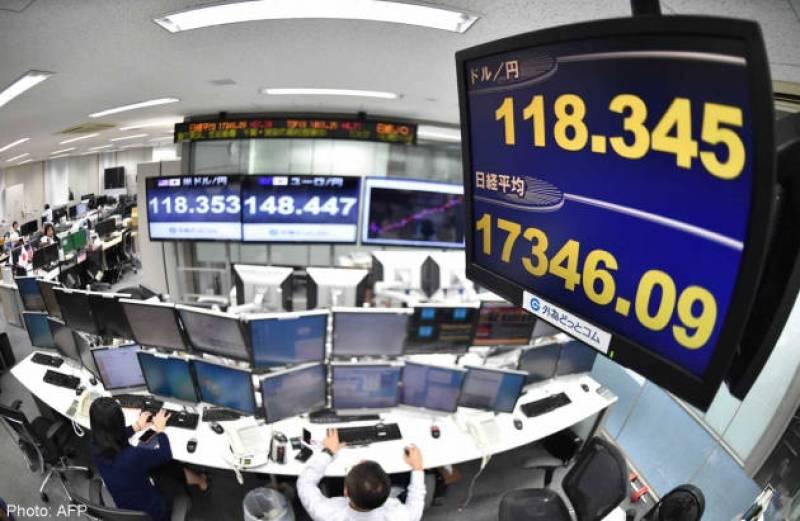 Asia stocks mostly up, euro struggles on ECB stimulus