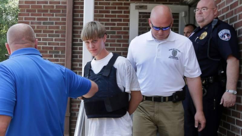 Charleston church shooting suspect taken into custody, community mourns