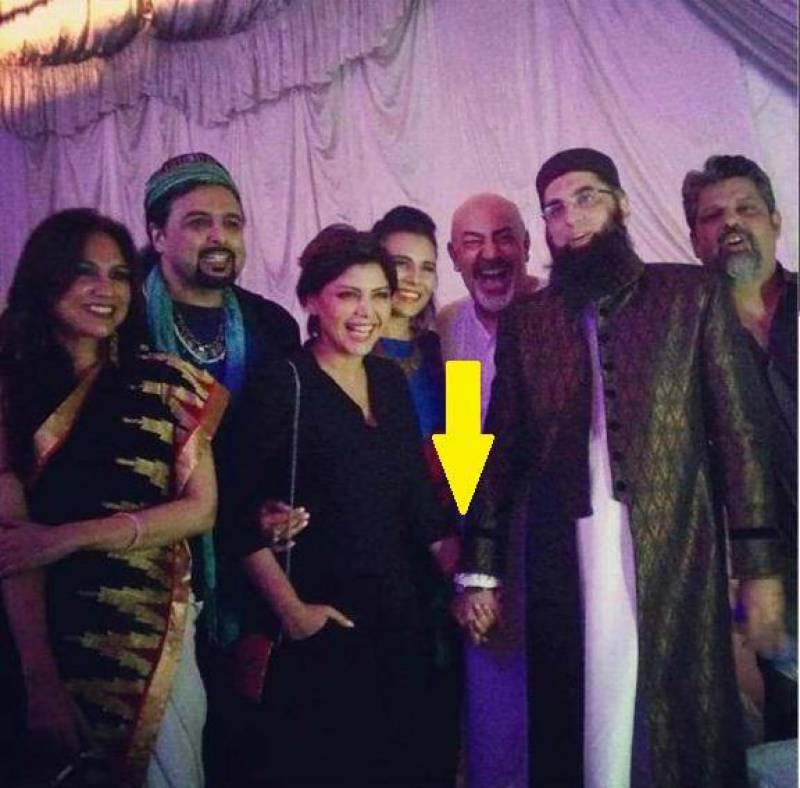 Junaid Jamshed is being criticized for holding Hadiqa Kiyani's hand