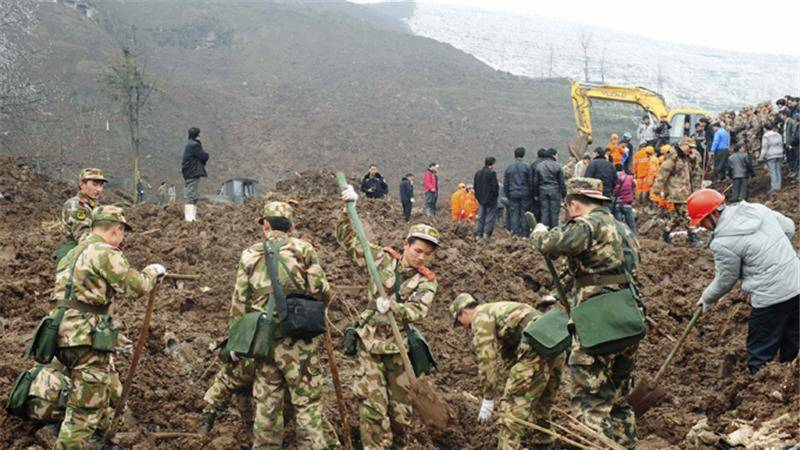 Landslide in China buries dozens of mining workers