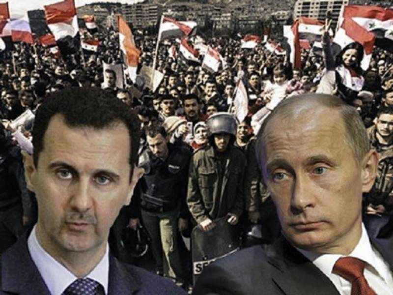 Putin says Assad could share power with opposition