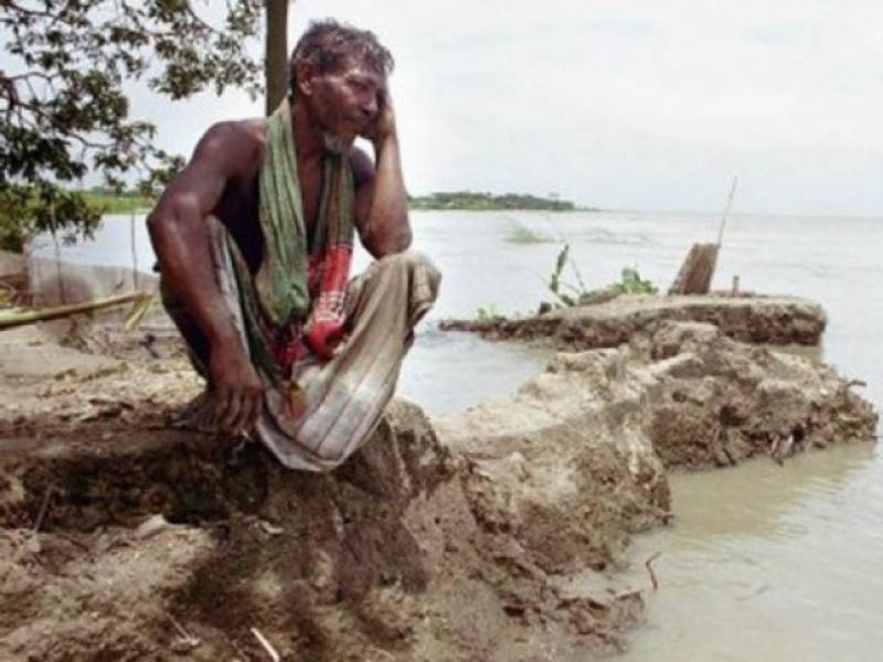 To help climate migrants, Bangladesh takes back land from the sea
