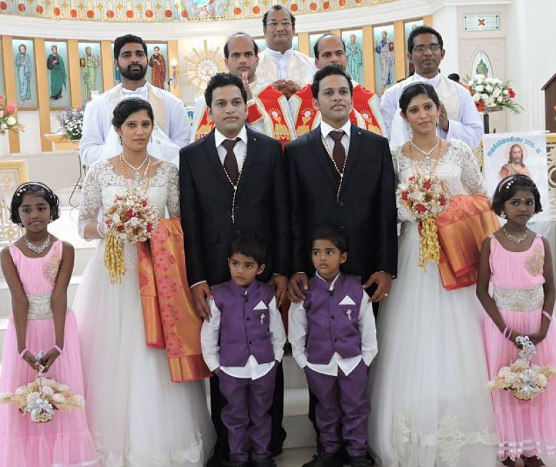 Everthing Seems So Similar: India's identical twin priests administer weddings of twin grooms with twin brides