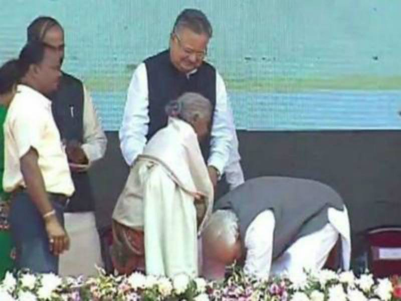 Modi touches woman's feet who sold her goats to build toilets