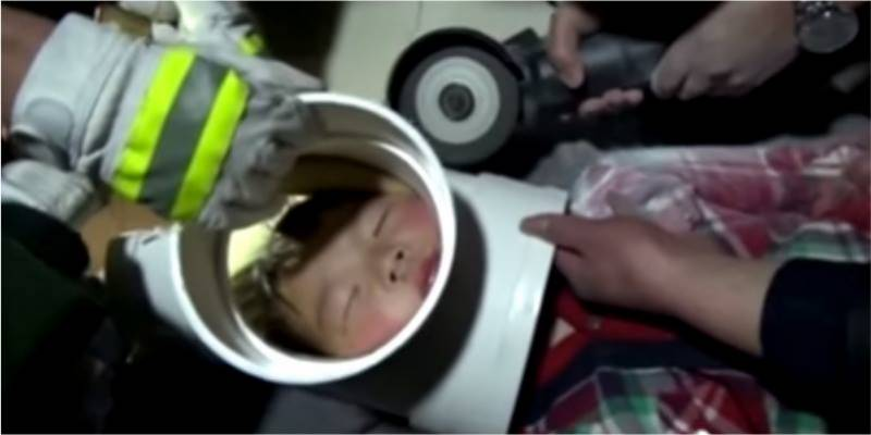 Five year old boy gets his head stuck in plastic pipe
