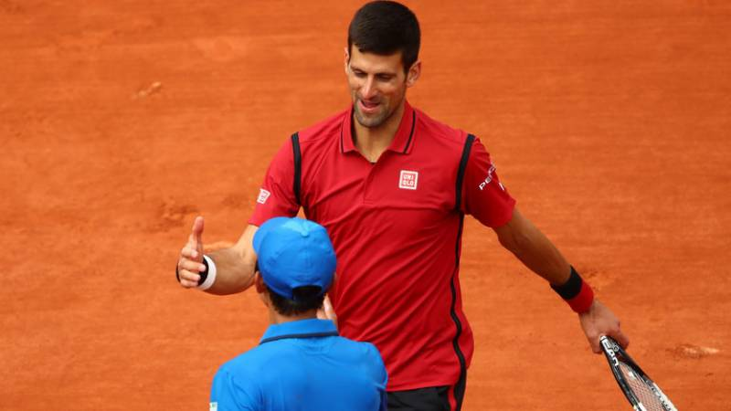 Djokovic's drive for glory at Garros boosted by Nadal withdrawal