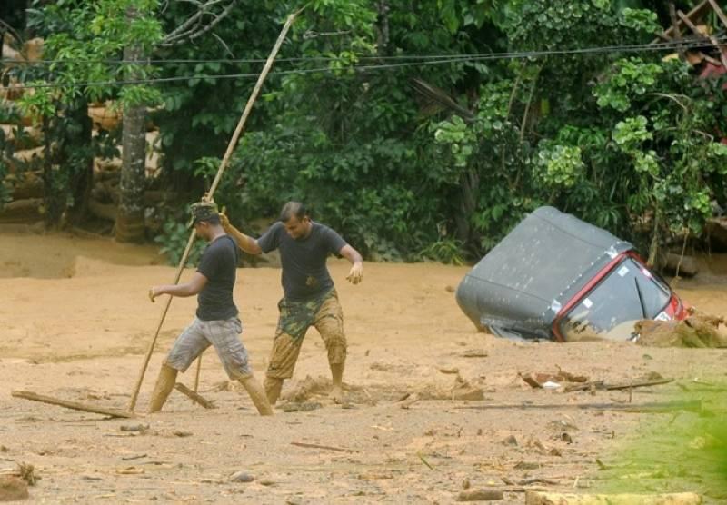 Sri Lanka says 100 missing in landslides are dead