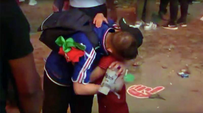 Portuguese boy consoles French fan after heartbreaking Euro 2016 final