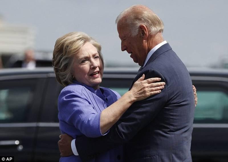 Harassment at the workplace? Joe Biden gives Hillary Clinton the most awkward hug