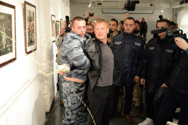 'Child pornography': Protester throws urine on American artist's pictures in Moscow gallery