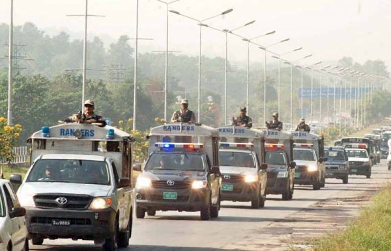 Police, Rangers hold flag march in capital ahead of Muharram
