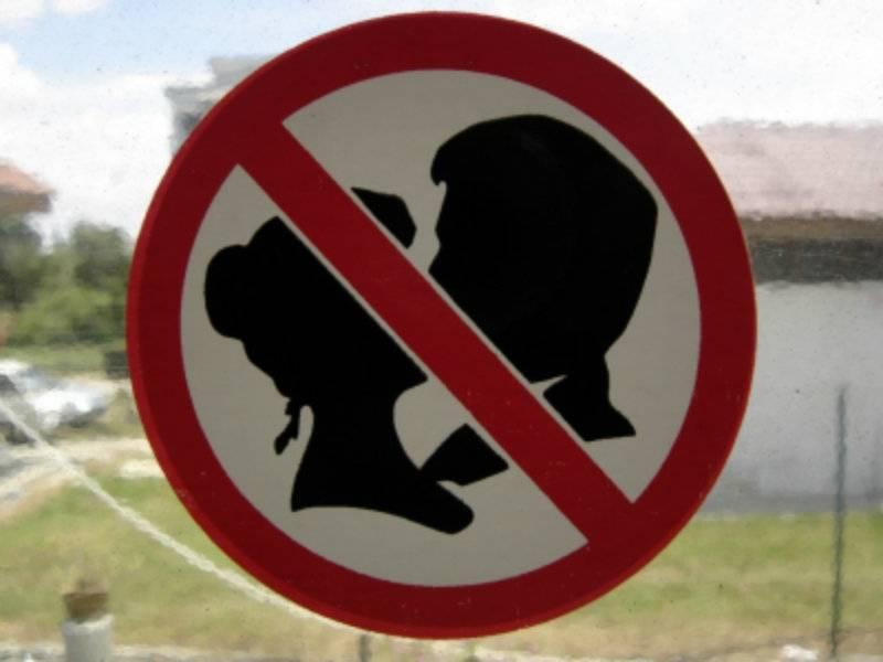 Teen girls face jail for kissing in public