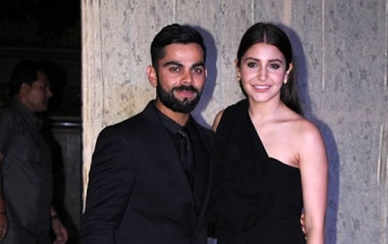 Virat Kohli and Anushka Sharma pose for paparazzi at Mumbai party (see photos and video)