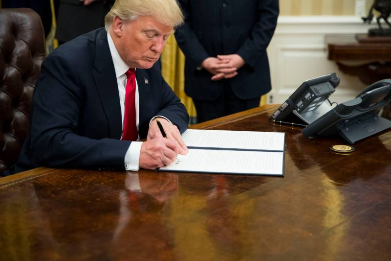 President Trump in action! signs first executive order against Obamacare health law