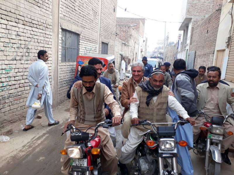 PTI's Shah Mehmood Qureshi kickstarts campaign on motorcycle for 2018 elections