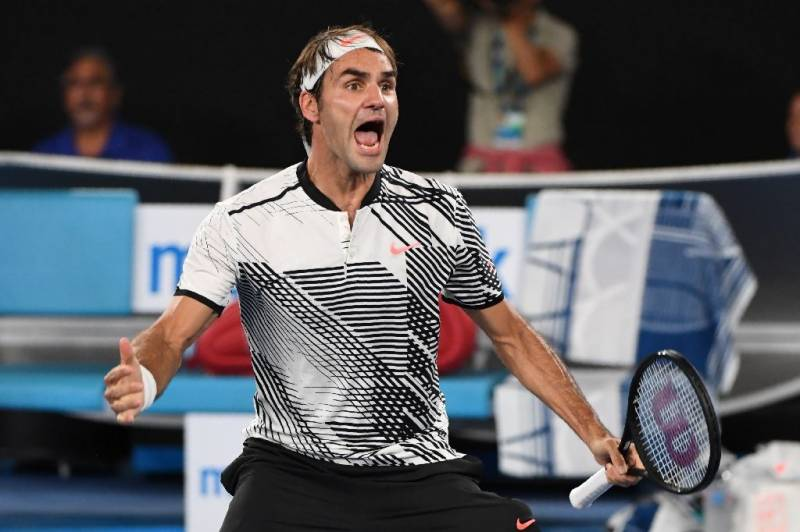 Federer thrashes Nadal in five-set thriller to win Australian Open
