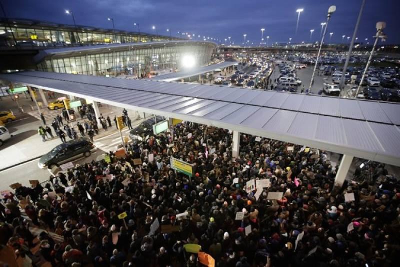 Hundreds gather at JFK airport to protest Donald Trump's Muslim ban