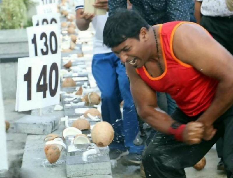 VIDEO: Indian man smashes 124 coconuts in 50 seconds with bare hands