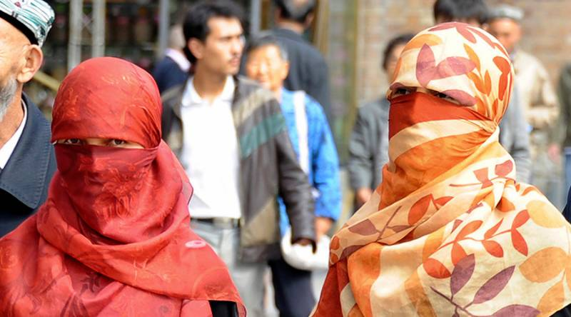 China bans beards, veils to curb extremism