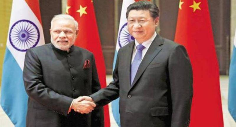 India withdraws forces from disputed border, confirms China