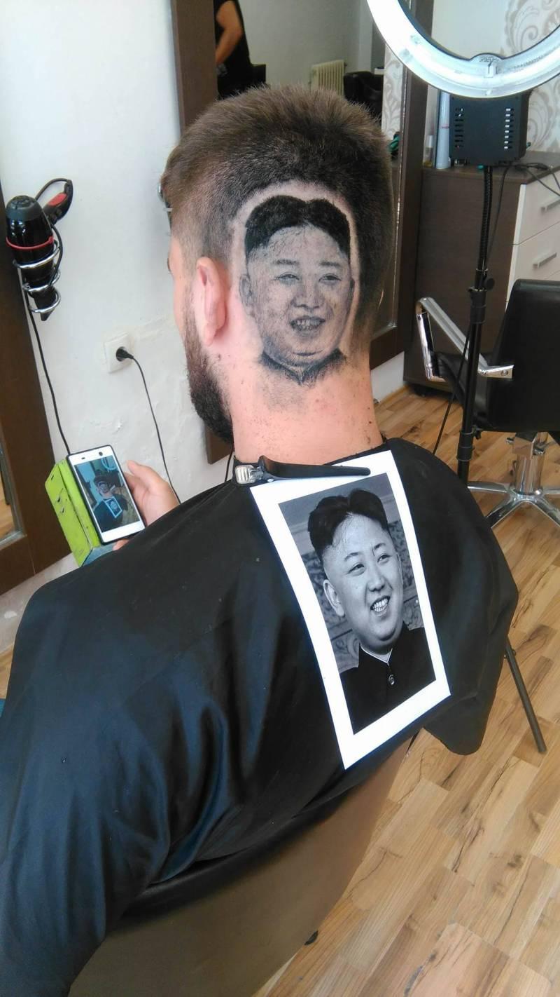 Barber shaves image of N Korea leader into client's scalp