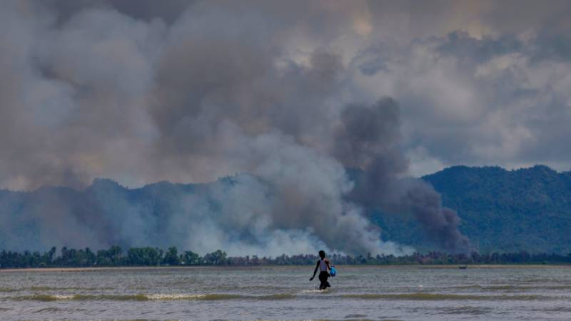 Myanmar minister says burned villages will become