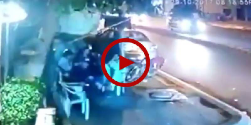 Commoners sitting beside road narrowly escape collision with high speed vehicle