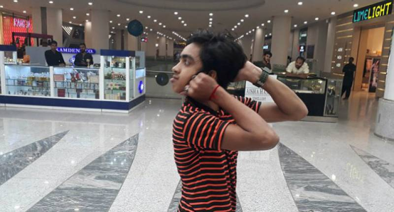 This 14-year-old 'human owl' from Pakistan can twist his head 180 degrees
