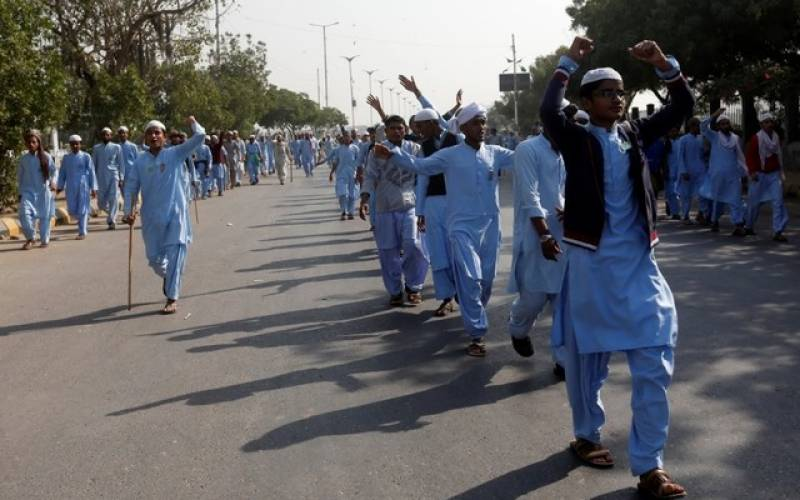 One dead and dozens injured after enraged protesters stage sit-ins across Pakistan against Islamabad operation