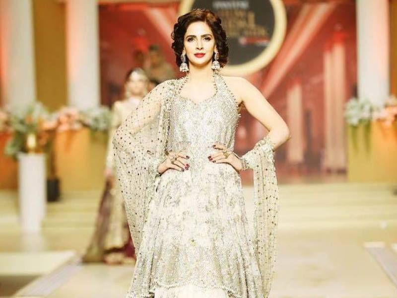 VIDEO: Saba Qamar expertly recovers from fall at Bridal Couture Week 2017 catwalk