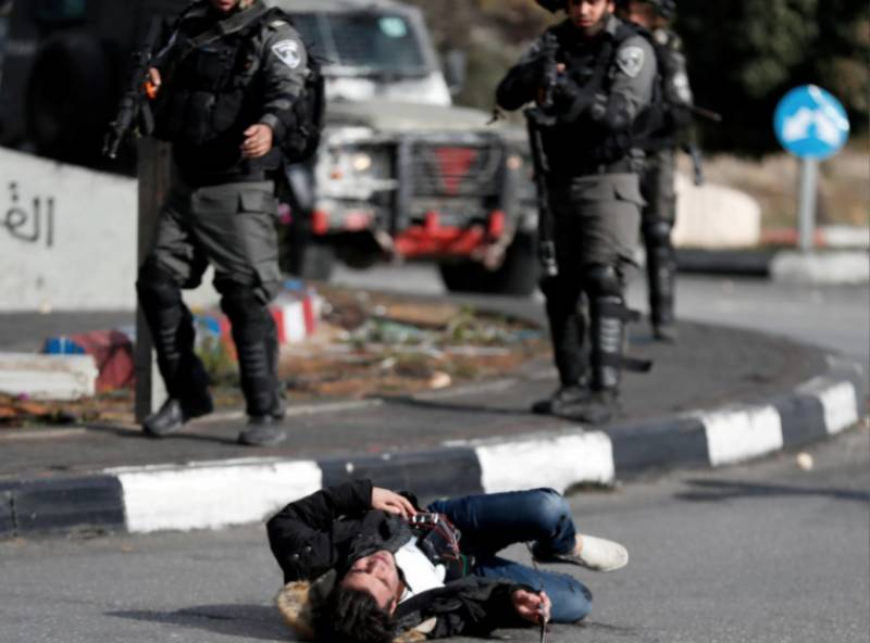 Israeli troops kill four Palestinians, including a wheelchair bound protester, over Jerusalem demos