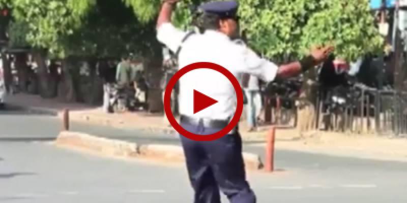 Indian cop 'moonwalks' to beat traffic chaos
