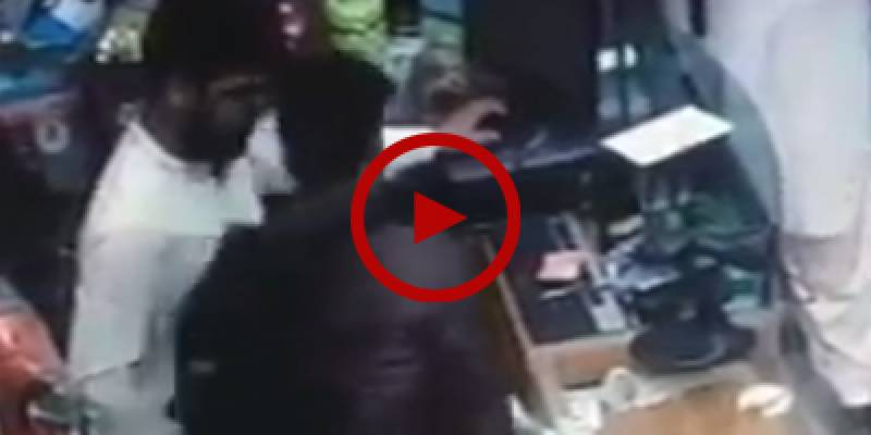 CCTV footage of armed robbery at mobile shop in Karachi