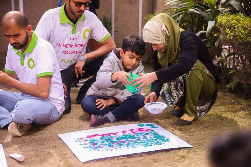 Zong 4G employees spend a day volunteering at the Autism Research Centre
