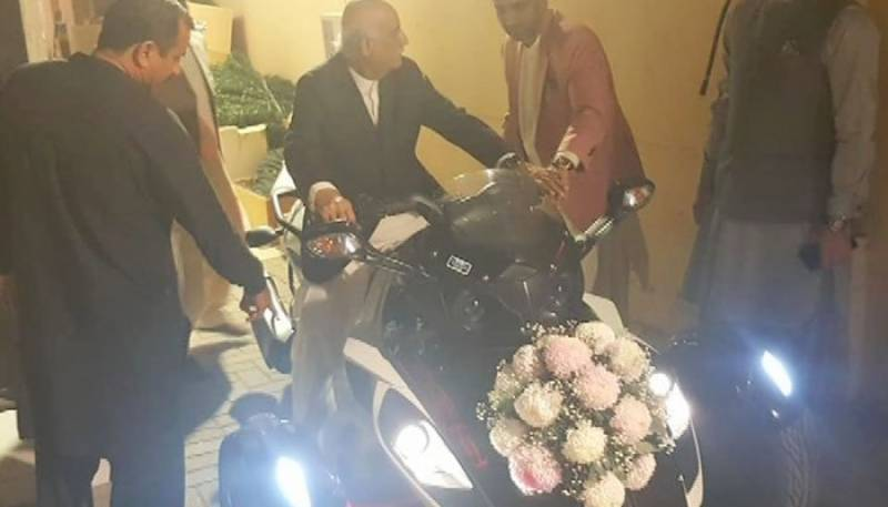 PPP's Khursheed Shah arrives at son's wedding on a HEAVY BIKE