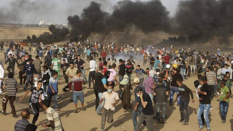 At least 61 killed by Israeli forces in Gaza protests as US opens embassy in Jerusalem