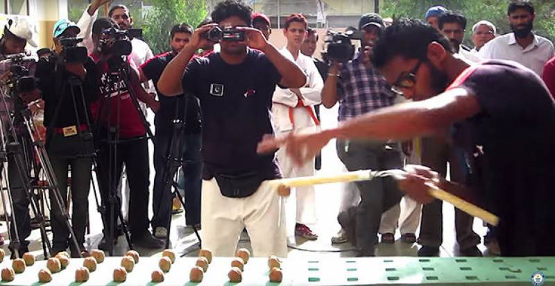 Pakistani fighter sets world record for smashing most walnuts in one minute