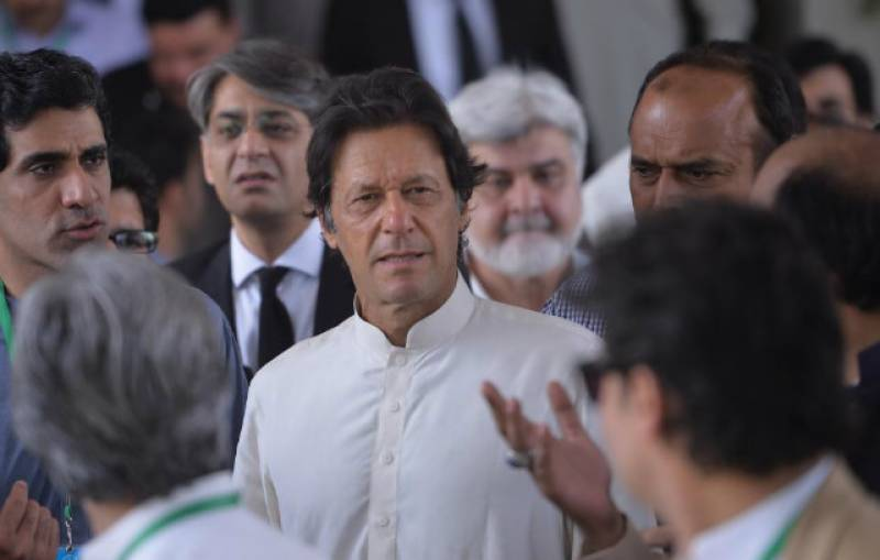 Imran Khan comes out of plane barefooted as he reaches Madinah