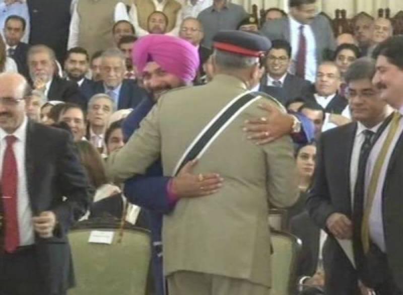Navjot Sidhu hugs COAS Qamar Bajwa, exchange pleasantries at Imran's swearing in