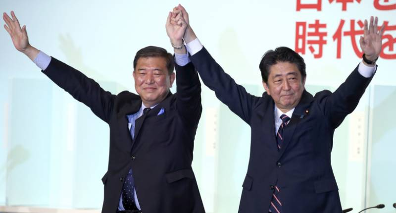 Japan's Abe to stay on as PM after re-election as party head