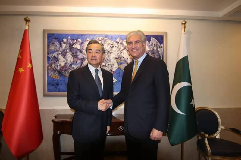 Awaiting PM Imran's visit to China, Yi tells Qureshi