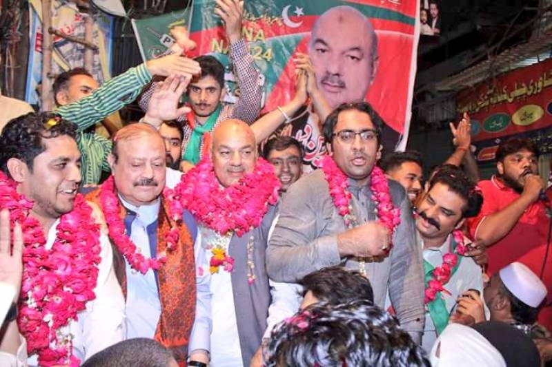 PTI candidate for NA-124 by-poll booked over arms display