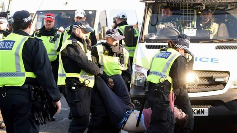 Mass arrests in UK after thousands close London bridges during climate change rally
