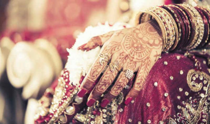This bride wore a plain beige lehnga with no embroidery on her wedding