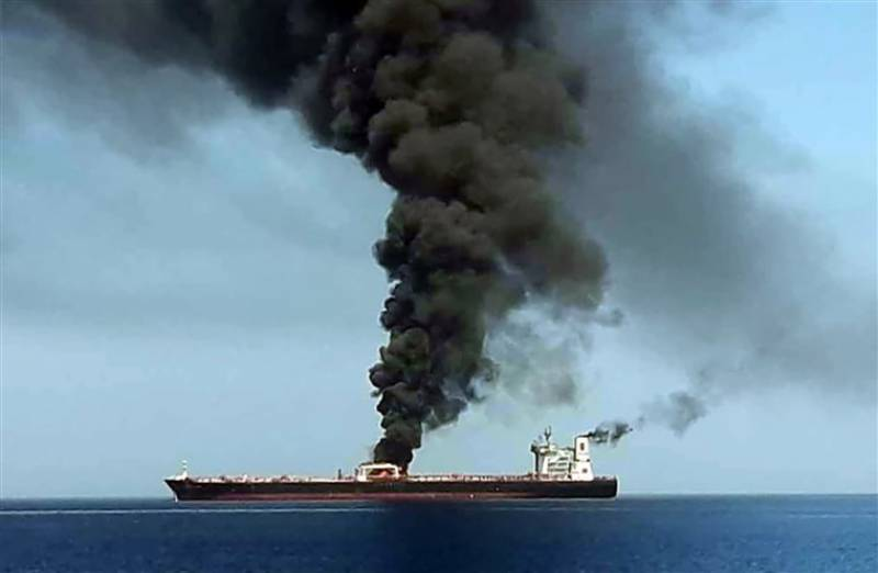Two tankers catch fire after suspected Gulf of Oman attacks