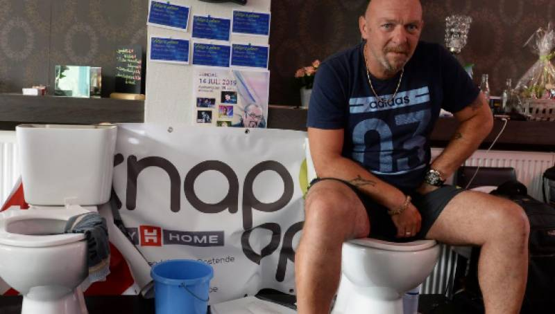 Belgian man tries to set world record by sitting on toilet for almost 165 hours