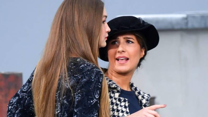 Gigi Hadid saves the day after woman hilariously crashes Paris Fashion Week show