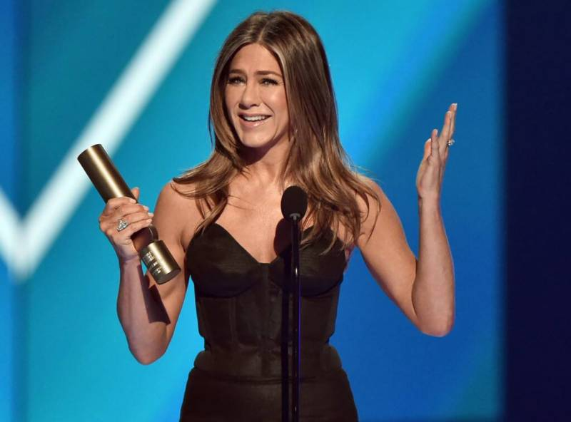 Jennifer Aniston tears up as she accepts the People's Icon Award from friend Adam Sandler