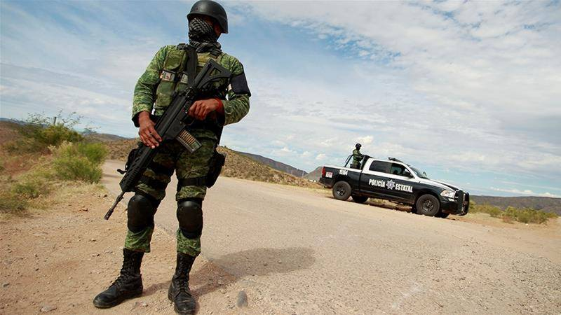 At least 14 killed in shootout between police, Mexican Cartel gunmen