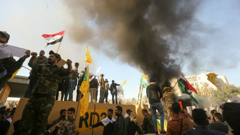 Iraqi PM issues warning after pro-Iran protesters torch US embassy